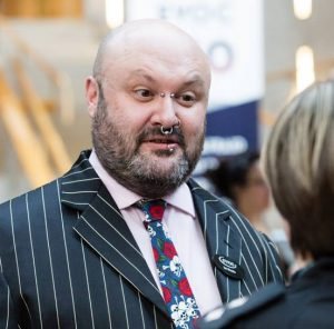 Photo of Ian Brooke in a suit